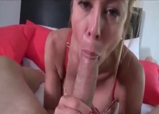 Blond-haired mommy with big tits sucking in POV