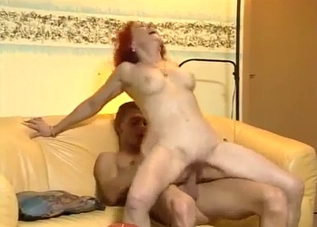 Redheaded MILF riding her hung son here