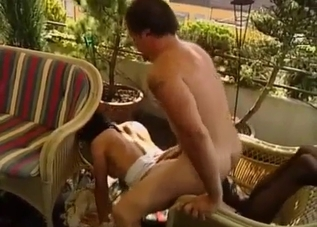 Brunette with stockings raped on the balcony