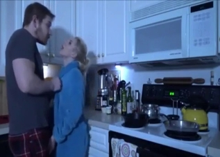 Mommy seduces her son in the kitchen
