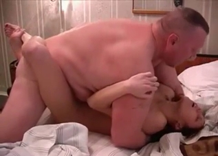 Redhead sucking her dad's dick attentively