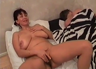 Kinky MILF stroking her son's cock