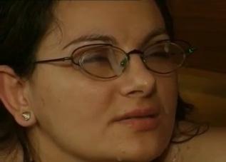 Brunette in glasses covered in cum