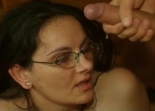Brunette in glasses covered in cum