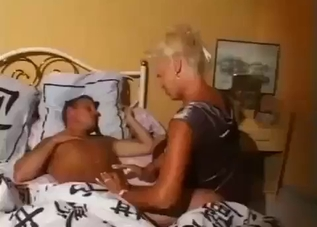 Tanned MILF sneakily blows her boy