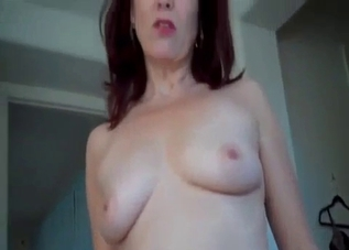 Redheaded mommy gives POV footjob