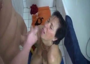 Dark-haired Russian MILF face-fucked