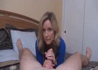 Elegant-looking mom jerking her son