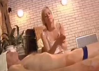 Blonde massaging her kinky daddy